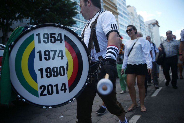 Fans of Germany's national team march along Copacabana Beach ahead of the 2014 FIFA World Cup final match against Argentina on July 13, 2014 in Rio de Janeiro, Brazil. The match will be held at the famed Maracana stadium. (Mario Tama/Getty Images)