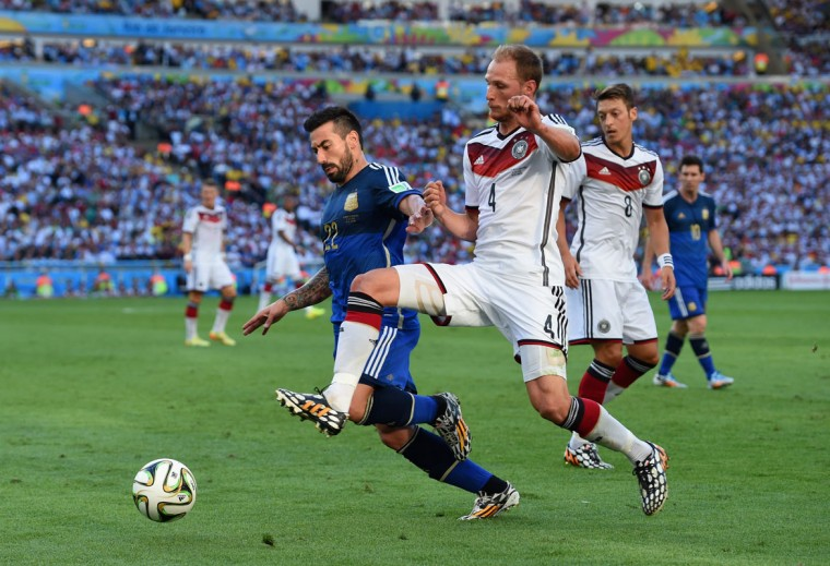 Benedikt Hoewedes of Germany challenges Ezequiel Lavezzi of Argentina during the 2014 FIFA World Cup Brazil Final match between Germany and Argentina at Maracana on July 13, 2014 in Rio de Janeiro, Brazil. (Matthias Hangst/Getty Images)