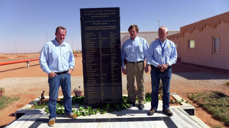 Algerian anniversary: Statoil's project manager, Norway's Kolbjoern Kirkeboe (second from right) poses with two of his compatriots and fellow hostages next to a memorial for the In Amenas hostage crisis, on August 23, 2013 in In Amenas, as they return to the site for the first time since they were taken hostages along with some 800 people. At least 39 foreign hostages were killed on January 20, 2013 during a raid by the Algerian special forces in an effort to free the hostages, four days after the start of the crisis. (Getty Images)