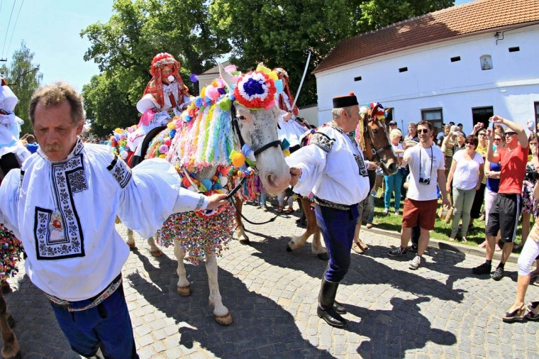 Eleven-year-old Frantisek Soban (C) dressed as a girl and with a rose in his mouth leads the royal procession during Ride of the Kings in Vlcnov, south Moravia, in the Czech Republic on May 25, 2014. The Ride of the Kings is one of the most famous folk customs of the country.A Czech composer who celebrated Moravian traditions in  much of his work was born 160 years ago today on July 3, 1854.   || CREDIT: RADEK MICA - AFP/GETTY IMAGES