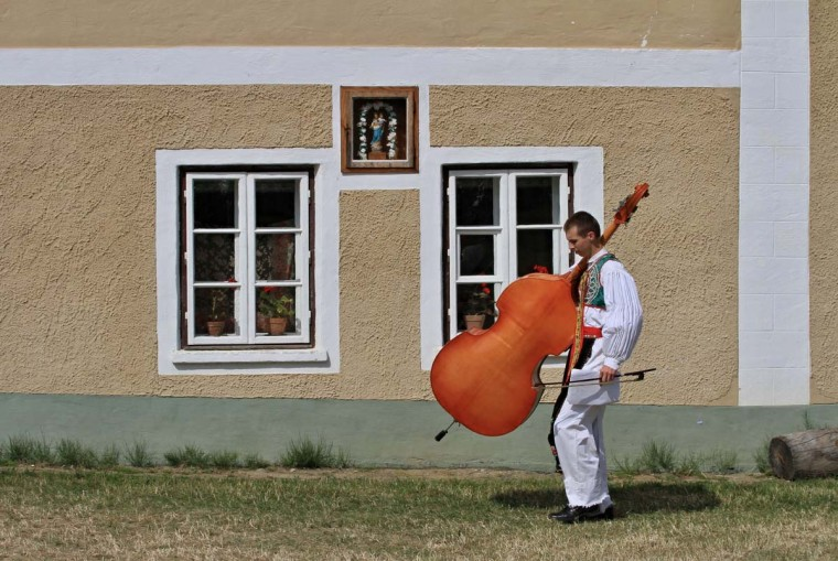 A young man carries his instrument during the oldest folklore festival of Europe in Straznice, south Moravia, 80 km southeast from Brno, Czech Republic on June 29, 2014.  Leoš Janáček, a Czech composer who celebrated Moravian traditions in  much of his work was born 160 years ago today on July 3, 1854.     || CREDIT: RADEK MICA - AFP/GETTY IMAGES