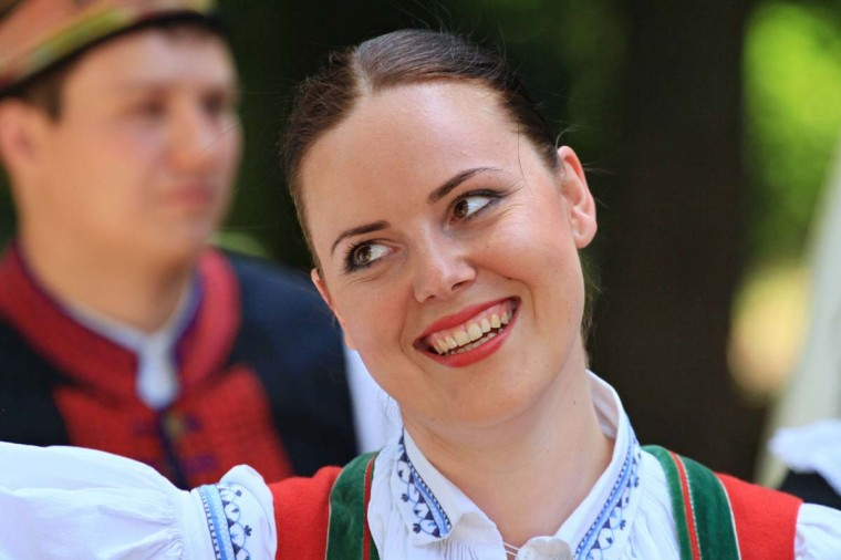 A woman celebrates during the oldest folklore festival of Europe in Straznice, south Moravia, 80 km southeast from Brno, Czech Republic on June 29, 2014.  A Czech composer who celebrated Moravian traditions in  much of his work was born 160 years ago today on July 3, 1854.   || CREDIT: RADEK MICA - AFP/GETTY IMAGES