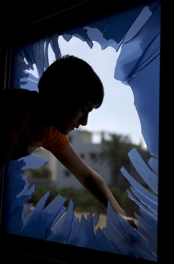 A Palestinian boy inspects damages following an overnight Israeli air strike, on July 3, 2014 in Beit Lahia in the northern Gaza Strip. Last night Israel launched some dozen air strikes on northern Gaza and Gaza City, wounding nine Palestinians, as angry Palestinian youths clashed the previous day with Israeli police following the kidnap and murder of a Palestinian teen in an apparent revenge attack. (Mohammed Abed/AFP/Getty Images)