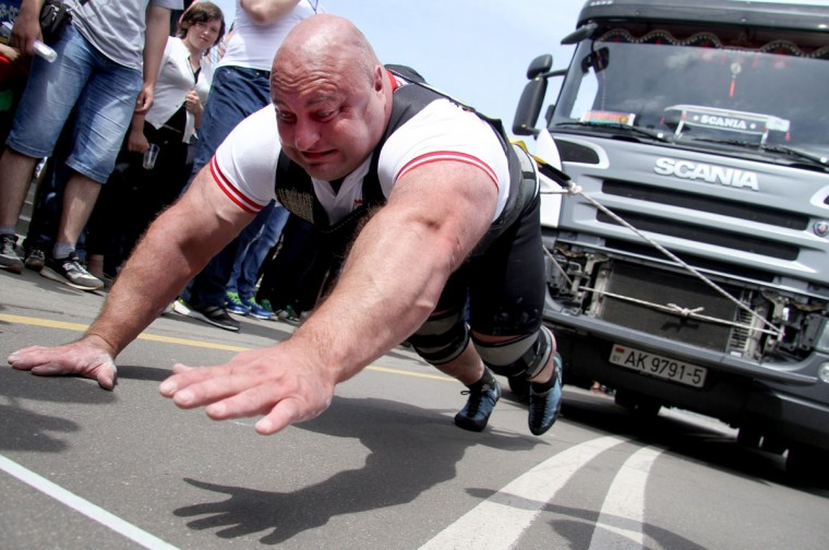 An athlete pulls a 15-tonne truck during a Truck-Pull event marking the upcoming Independence Day in the Belarus capital Minsk, on July 3, 2014. The former Soviet nation celebrates its Independence Day on July 3 in memory of the end of Belarus occupation by Nazi Germany troops during the Red Army main summer offensive in 1944. (Sergei Gapon/AFP/Getty Images)