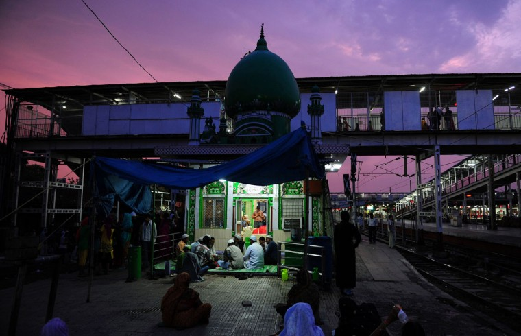 Indian Muslim devotees break their Ramadan fast outside the Shah Baba Mosque at Allahabad Junction railway station in Allahabad on July 3, 2014. Like millions of Muslim around the world, Indian Muslims celebrate the month of Ramadan by abstaining from eating, drinking, and smoking as well as sexual activities from dawn to dusk. (Sanjay Kanojia/AFP/Getty Images)