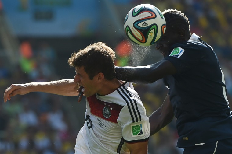 Germany forward Thomas Mueller (left) vies with France defender Mamadou Sakho during the quarterfinal World Cup match at Rio de Janeiro's Maracana Stadium. Germany won, 1-0. (YASUYOSHI CHIBA/AFP/Getty Images)
