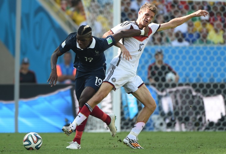 Germany's Thomas Mueller (right) tackles France's Paul Pogba during the World Cup quarterfinal at Maracana Stadium in Rio de Janeiro. Germany won, 1-0. (PATRIK STOLLARZ/AFP/Getty Images)