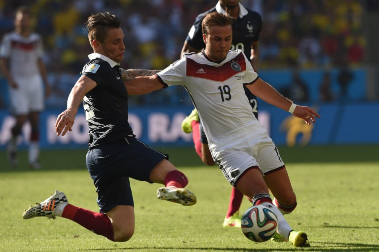France's Mathieu Debuchy (left) and Germany's Mario Goetze battle for the ball during Germany's 1-0 win in the World Cup quarterfinal match Friday at Maracana Stadium. (PEDRO UGARTE/AFP/Getty Images)
