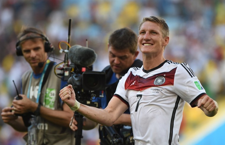 Germany midfielder Bastian Schweinsteiger celebrates after his team's 1-0 victory over France. (PATRIK STOLLARZ/AFP/Getty Images)