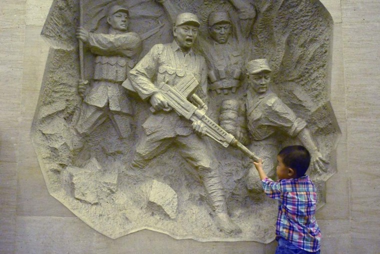 "A boy visits China's Anti-Japanese War museum at the Marco Polo bridge, or Lugouqiao, in west Beijing on July 7, 2014, on the the 77th anniversary of the Marco Polo Bridge incident, a skirmish between Chinese and Japanese troops that served as a pretext for Tokyo's forces to seize Beijing and trigger the Sino-Japanese war. Chinese President Xi Jinping on July 7 commemorated the 77th anniversary of the official start of war with Japan, condemning those who ""ignore the iron facts of history"" in an oblique jab at Prime Minister Shinzo Abe.(Wang Zhao/AFP/Getty Images)"