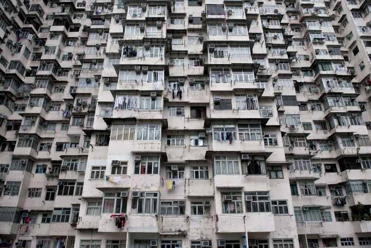 Residential units are seen clustered tightly together in an apartment complex in the Quarry Bay area of Hong Kong on July 7, 2014. Housing prices in the southern Chinese city have roughly doubled since 2009, with prices being pushed up by buyers from mainland China, in a trend towards even higher population density that now sees, according to government estimates, around 170,000 people living in tiny subdivided apartments in and around already cramped residential units. (Alex Ogle/AFP/Getty Images)
