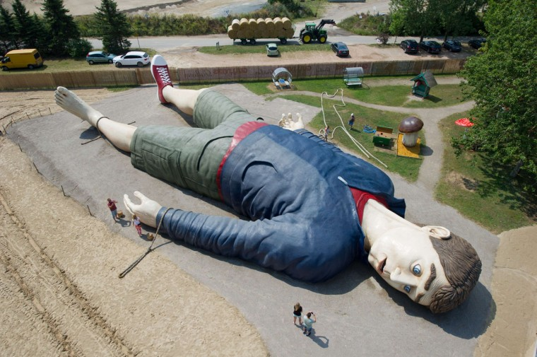 "Workers work at the 'Gulliver' sculpture on July 8, 2014 in the amusement park ""Gulliver's World"" in Pudagla, on the island of Usedom, Germany. The sculpture of ""Gulliver in Lilliput"" is 36 meters long and 17 meters wide, which is one of the largest of its kind in Europe. The sculpture will be shown from July 11, 2014. (AFP/Getty/Stefan Sauer)"
