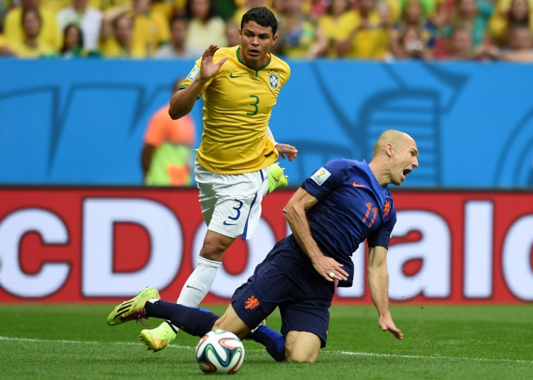 Brazil's defender and captain Thiago Silva (L) reacts after fouling Netherlands' forward Arjen Robben in the penalty area during the third place play-off football match between Brazil and Netherlands during the 2014 FIFA World Cup at the National Stadium in Brasilia on July 12, 2014. (Vanderlei Almeida/AFP/Getty Images)