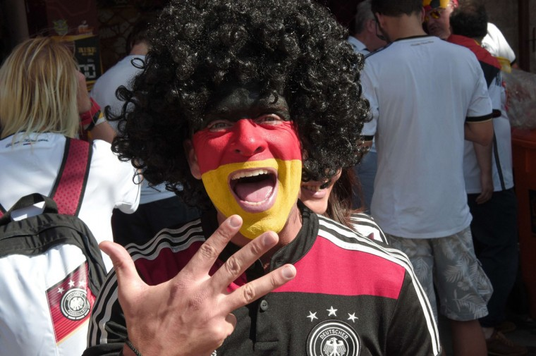 A Germany fan with his face painted in Germany's national colors cheers prior to the 2014 FIFA World Cup final football match between Germany and Argentina at the Maracana Stadium in Rio de Janeiro, Brazil on July 13, 2014. (Damien Meyer/AFP/Getty Images)