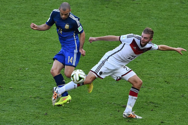 Germany's midfielder Christoph Kramer (R) and Argentina's midfielder Javier Mascherano compete for the ball during the final football match between Germany and Argentina for the FIFA World Cup at The Maracana Stadium in Rio de Janeiro on July 13, 2014. (Gabriel Bouys/AFP/Getty Images)