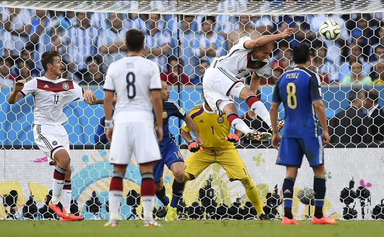 Germany's defender Benedikt Hoewedes (2R) heads the ball during the final football match between Germany and Argentina for the FIFA World Cup at The Maracana Stadium in Rio de Janeiro on July 13, 2014. (Fabrice Coffrini/AFP/Getty Images)