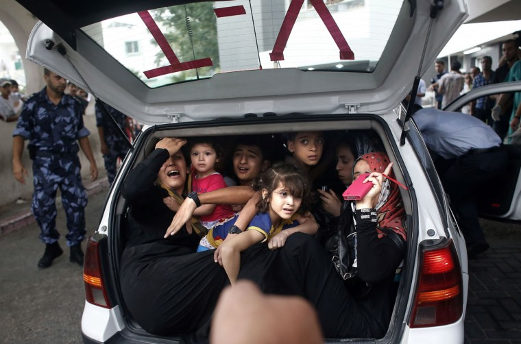 Injured Palestinians arrive at al-Shifa hospital in Gaza City on July 20, 2014. Israel's army said it was expanding its ground offensive against the Gaza Strip, as the bloodiest conflict since 2009 entered its 13th day with a death toll of over 360. (Thomas Coex/AFP/Getty Images)