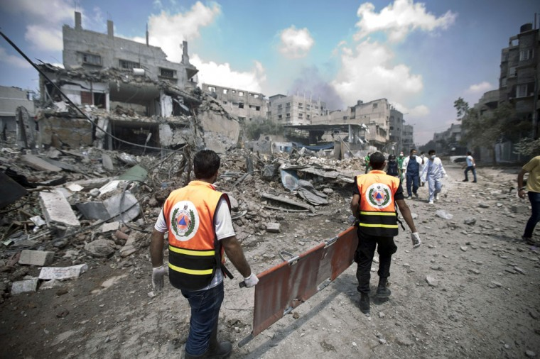 Palestinian medics search for survivors amidst the rubble in Gaza's eastern Shejaiya district on July 20, 2014. At least 40 people were killed and nearly 400 wounded in Israeli shelling of Gaza's northeastern Shejaiya district overnight, medics said. (Hams Mahmud/AFP/Getty Images)