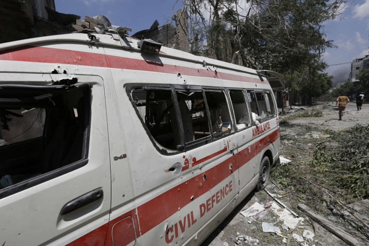 "A destroyed Civil Defence ambulance is seen on a street following an Israeli military offensive on the Shejaiya neighborhood between Gaza City and the Israeli border, which has left more than 50 people dead in a blistering bombardment which began overnight, medics said on July 20, 2014. The death toll in Gaza passed 400 as Israel pressed its biggest offensive in the enclave in five years, Palestinian health officials said. ""410 people have been killed since the war started and more than 3,020 people have been injured, most of them civilians,"" deputy health minister Yussef Abu Rish told reporters at al-Shifa hospital in Gaza City. (Mohammed Abed/AFP/Getty Images)"
