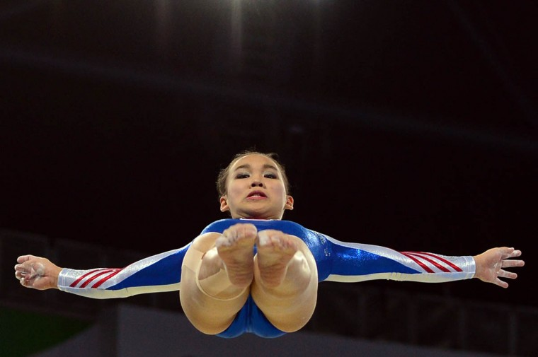 Tracie Ang of Malaysia performs on the beam during the Team Final and Individual qualification of the Artistic Gymnastics event during the 2014 Commonwealth Games in Glasgow, Scotland. (Carl Court/Getty Images)