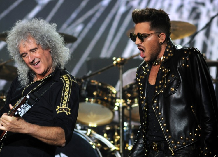 Queen guitarist and song writer Brian May, left, and Adam Lambert perform with the rest of the band at the Merriweather Post Pavilion. (Algerina Perna/Baltimore Sun)