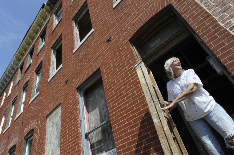 Kristine Balazs stands in the doorway of her Lombard St. home she is renovating.(Jed Kirschbaum/Baltimore Sun/Aug. 2011)