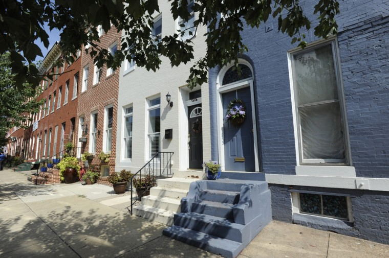 Homes in the 1300 block of West Lombard St. in 2011. Residents of Union Square, including former neighborhood association president Chris Taylor have successfully decreased the vacancy rate in their neighborhood from 50 percent. (Jed Kirschbaum/Baltimore Sun/Aug. 2011)