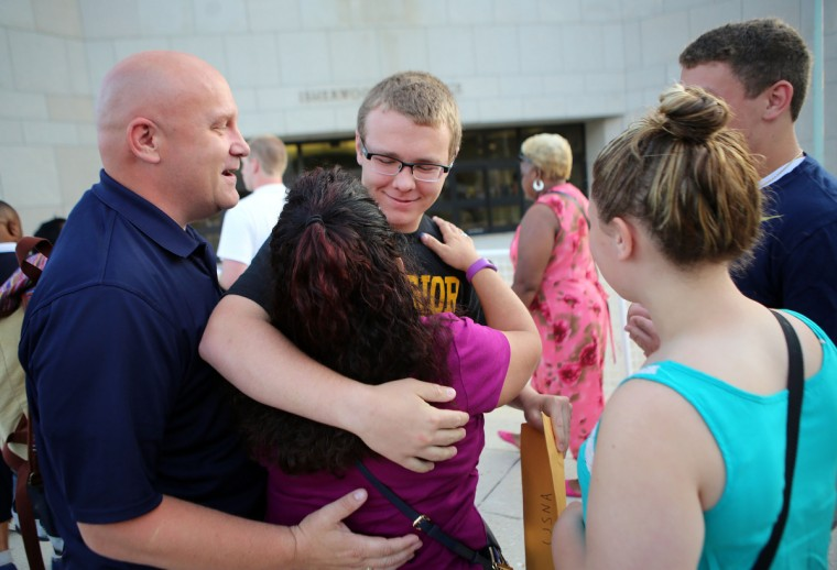 Incoming plebe Jack McGillick, from Harrison City, Penn., hugs his mother Eva and father John before leaving them on Induction Day at the U.S. Naval Academy. (Al Drago/Baltimore Sun)