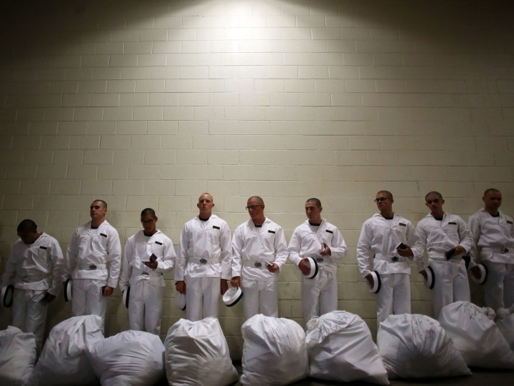 Prospective plebes stand in line after receiving their gear and before they learn how to salute during Induction Day at the U.S. Naval Academy. (Al Drago/Baltimore Sun)