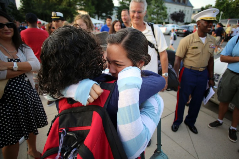 Riley Hill, 17, right, hugs her sister Shannon Hill, from Ventura County, Calif., as Shannon becomes an incoming plebe on Induction Day at the U.S. Naval Academy. (Al Drago/Baltimore Sun)