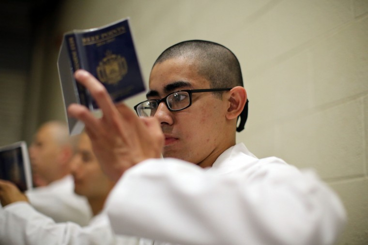 A Plebe studies his reef points, which contain basic information on how to act as a midshipmen during Induction Day at the U.S. Naval Academy. (Al Drago/Baltimore Sun)