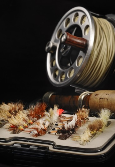 This is an assortment of dry flies pictured with a Bauer M1 Super Light fly reel. (Kenneth K. Lam/Baltimore Sun)