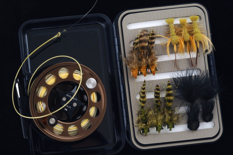 Pictured are an assortment of small-mouth bass flies with a Bauer fly reel. (Kenneth K. Lam/Baltimore Sun)