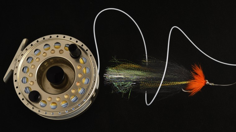 A Dan Blanton's Flash Tail Whistler is pictured with a Tibor Rip Tide fly reel. (Kenneth K. Lam/Baltimore Sun)