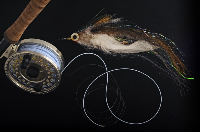 A Don Brown Bill fish fly is pictured with a Tibor Rip Tide fly reel. This large saltwater fly is used to fish for tuna, sailfish and marlins. (Kenneth K. Lam/Baltimore Sun)