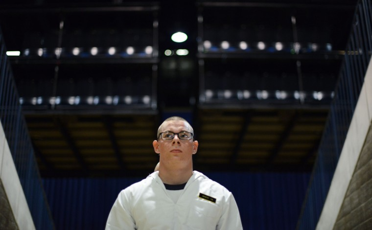 Plebe Anthony White stands waiting to be called into a different station in Alumni Hall for Induction Day. (Rachel Woolf/Baltimore Sun)