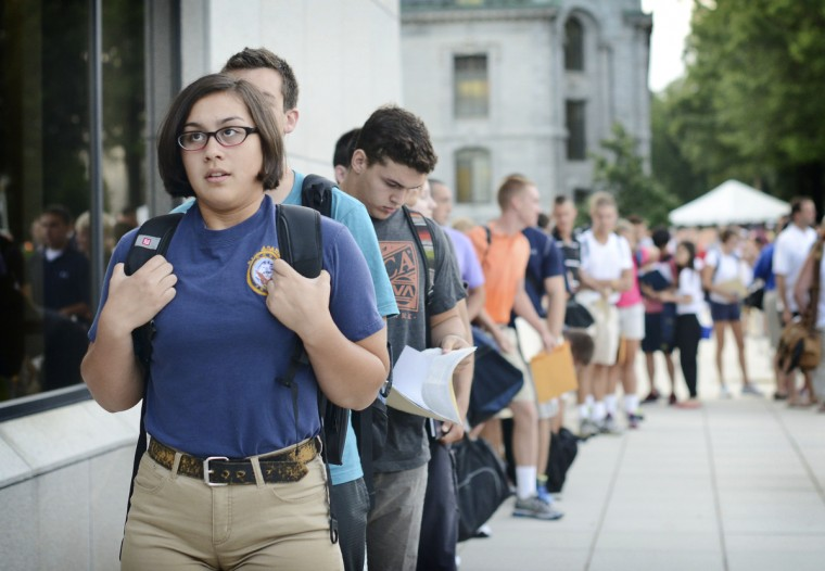 Plebe Leah Ayres, of Florida, takes a deep breath while standing in line before she walks inside the Naval Academy Alumni Hall. (Rachel Woolf/Baltimore Sun)