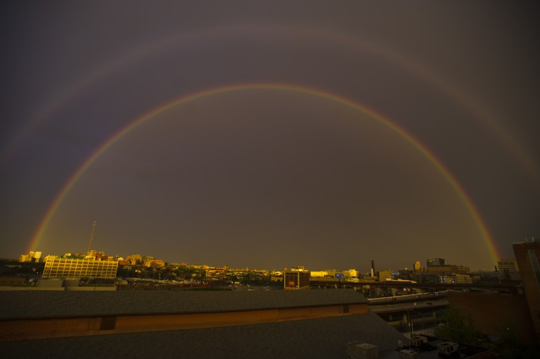 Rain from a fast-moving front result in a double rainbow in a view looking southeast from a parking garage above the Merritt Athletic Club Tuesday, Jul 8, 2014. (Karl Merton Ferron/Baltimore Sun Staff)