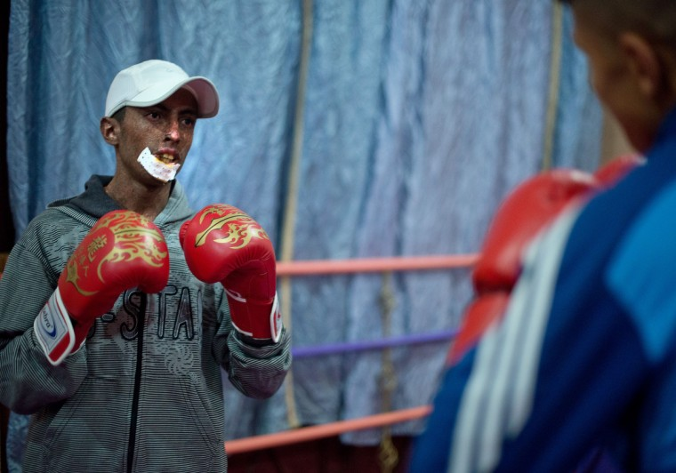 Driss Hamouti, 21, fights against Salahdine Aziz, 18, both of Tiflet Morocco, during Driss' kickboxing class. Normally, Driss will spar with a boxing bag instead of with a person as he finds it more tiring to keep up with other people. Rachel Woolf/Baltimore Sun
