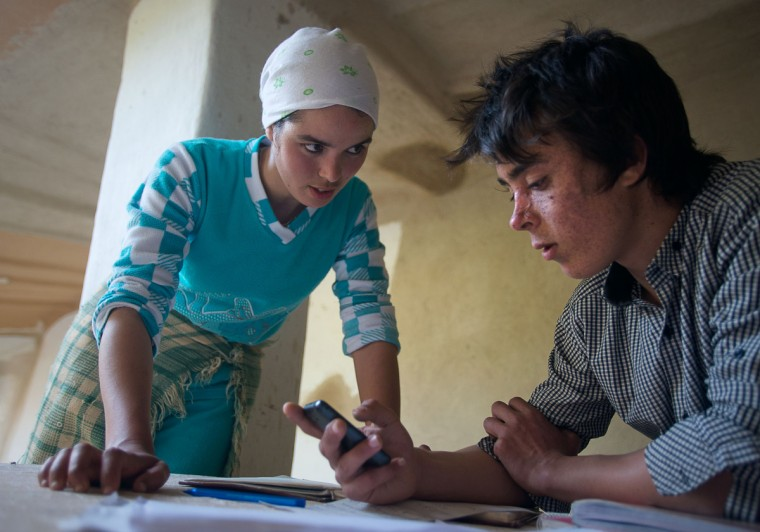 From left, Nadia El-Kotbi, 22, talks with her brother, Mohamed El-Kotbi, 17, both of the Province of Ouezzane, Morocco, about music while Mohamed takes a break from his math homework. Mohamed rents a room near his high school and spends weekends and holidays at his parent's home. Rachel Woolf/Baltimore Sun