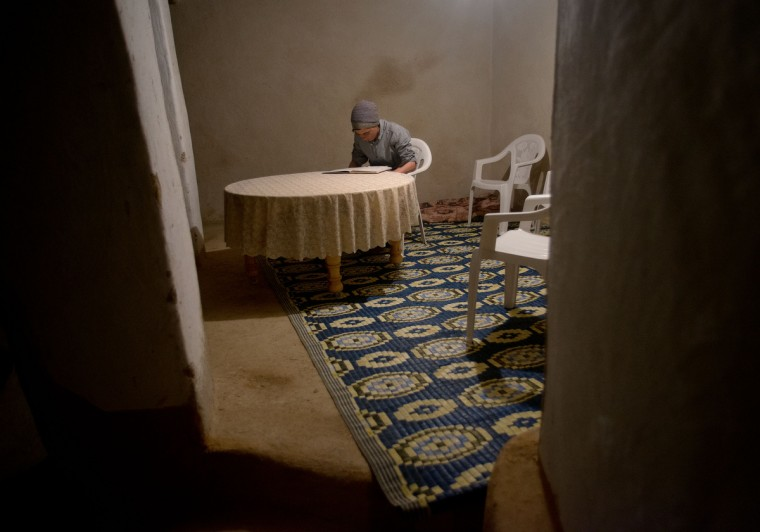 Mohamed El-Kotbi, 17, of the Province of Ouezzane, Morocco, works on homework late at night in his parent's house. Rachel Woolf/Baltimore Sun
