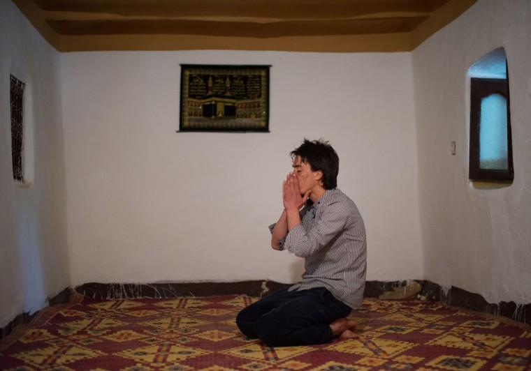 Mohamed El-Kotbi, 17, of the Province of Ouezzane, Morocco, prays during the morning prayer. Rachel Woolf/Baltimore Sun
