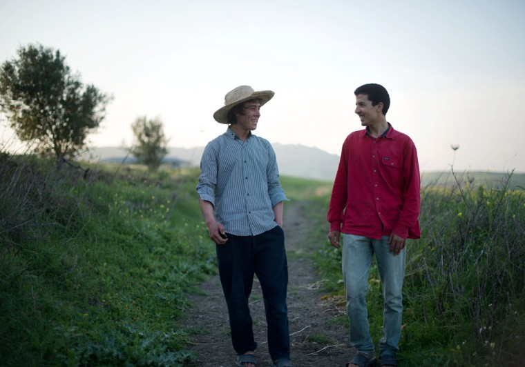 From left, Mohamed El-Kotbi, 17, and his brother, Chouaib El-Kotbi, 20, both of the Province of Ouezzane, Morocco, walk through their village together. Rachel Woolf/Baltimore Sun