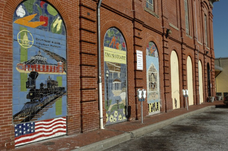Baltimore scenes are painted on the brick facade of the Hollins Market which is in the Hollins Market Historic neighborhood, near Union Square. (Algerina Perna/Baltimore Sun/Oct. 2008)