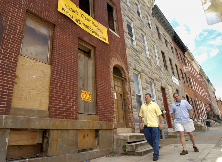 Mike Aubele, left, and Todd Wetzelberger, right,principals in Anchor Development, are helping to reshape the Union Square area by using city and state historic tax credits to rehab Victorian-era rowhouses for an affordable price. They are walking in the 1700 block of E. Lombard Street where they have completed one historic rehab, and are in the process of doing a second, the brick rowhouse at left. Buyers get a big break on their city taxes for ten years, and a percentage back on the purchase price from the state. (Amy Davis/Baltimore Sun photo/May 2008)