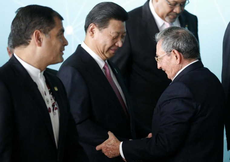 Ecuador's President Rafael Correa (at left) looks on during a meeting of China and Community of Latin American and Caribbean States (CELAC) on July 17. Ecuador announced Thursday that it was calling in its ambassador to Israel, according to La Informacion and El Universo. || PHOTO CREDIT: SERGIO MORAES  - REUTERS