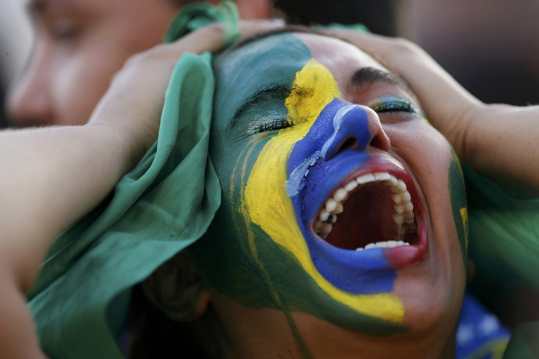 Fans of Brazil react while watching a broadcast of the 2014 World Cup semi-final against Germany at the Fan Fest in Brasilia, July 8, 2014. (Ueslei Marcelino/Reuters)