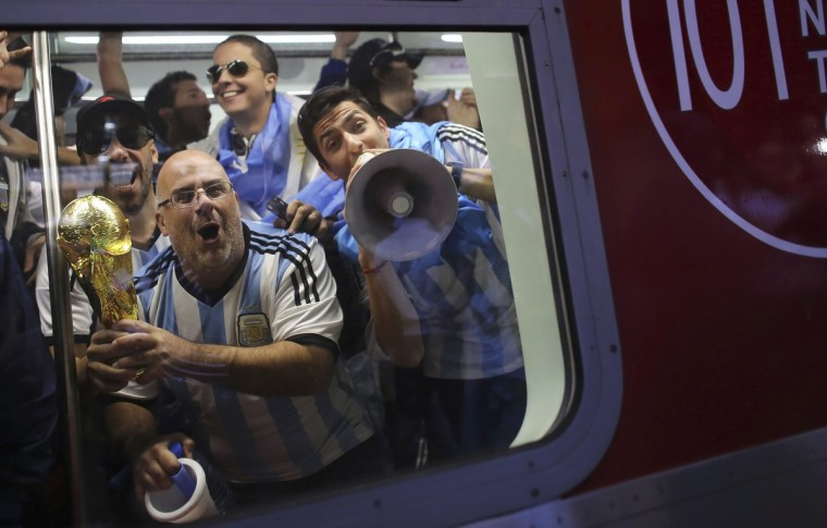 Argentina soccer fans celebrate as they travel on a train towards the Corinthians arena at the Luz Station before the 2014 World Cup round of 16 soccer match between Argentina and Switzerland in Sao Paulo July 1, 2014. (Nacho Doce/Reuters)