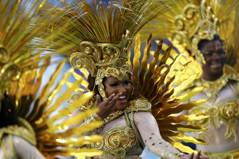 Dancers perform during the 2014 World Cup closing ceremony at the Maracana stadium in Rio