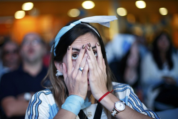 A fan of Argentina reacts while watching a broadcast of the 2014 World Cup final against Germany at the Argentine Embassy in Brasilia, July 13, 2014. (Ueslei Marcelino/Reuters)